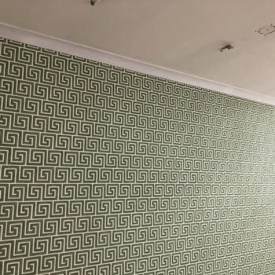 Installing Cole&Son wallpaper in Strand, London