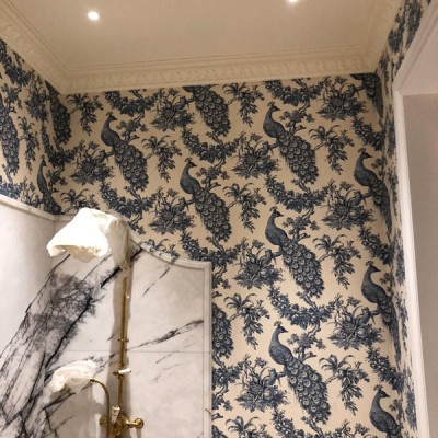 Installing Hamilton Weston Old Paradise wallpaper in Kensington, London