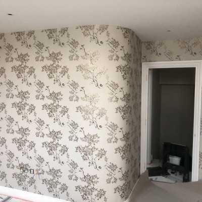 Installing Juliet Travers wallpaper in Parsons Green, London